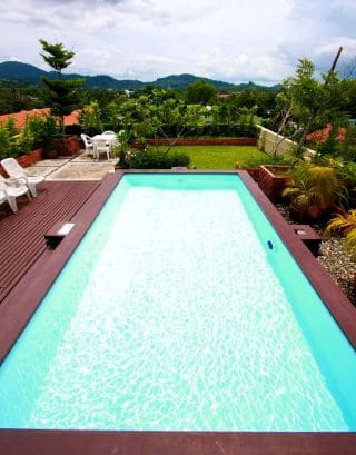 rooftop pool with mountain big buddha views, sunloungers and landscaping at our chalong studio apartments