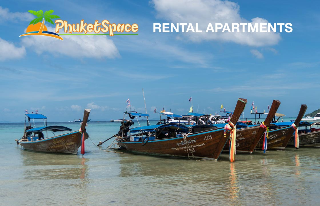 Long tail boats used for fishing and day trips for tourists at anchor in the andaman sea available to see close to our phuket apartment rent options
