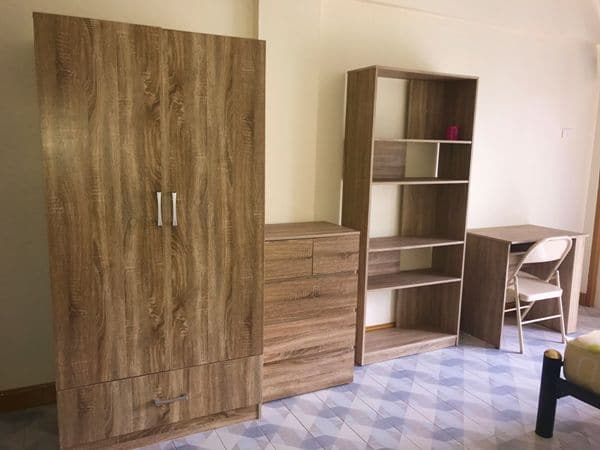 double wardrobe, chest of drawers, bookcase and computer desk with chair in standard Rawai apartment
